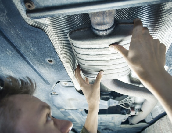 Car Exhaust Service by Mechanic